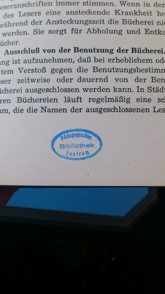 The safety stamp in the middle of the book - obviously smaller and oval.